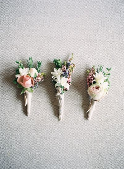 Floral boutonnieres for the groom and his groomsmen. Via Style Me Pretty