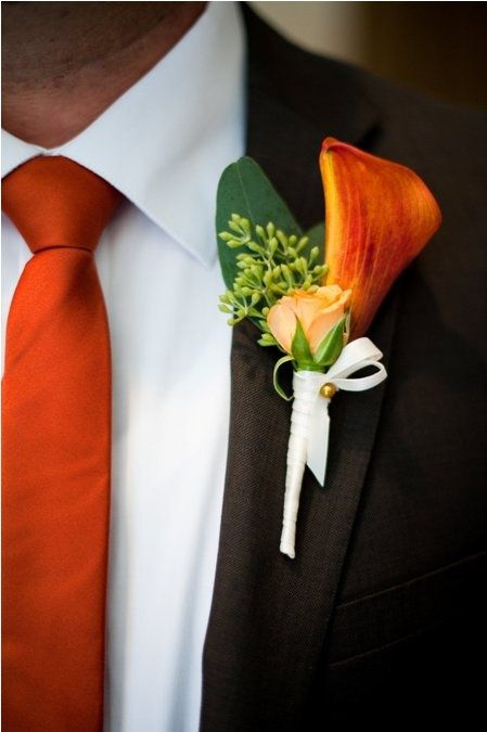 Simple and elegant orange floral boutonniere