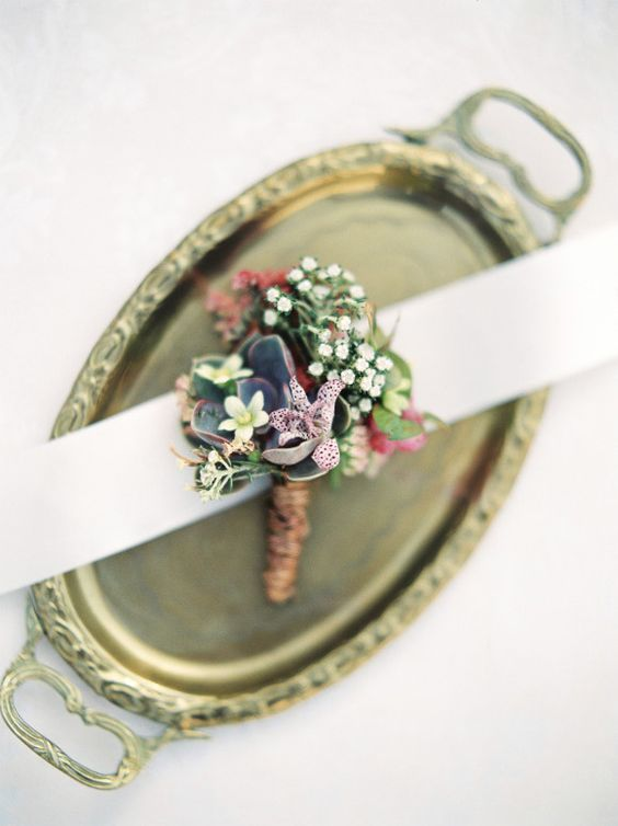 Delicate and warm floral boutonniere. Via Wedding Sparrow