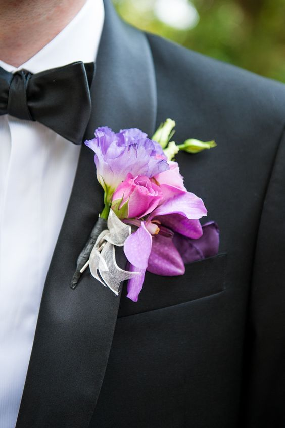 Vibrant boutonniere with flowers. Via Style Me Pretty