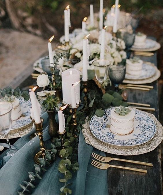 Romantic blue and gold wedding table setting. Via Pinterest