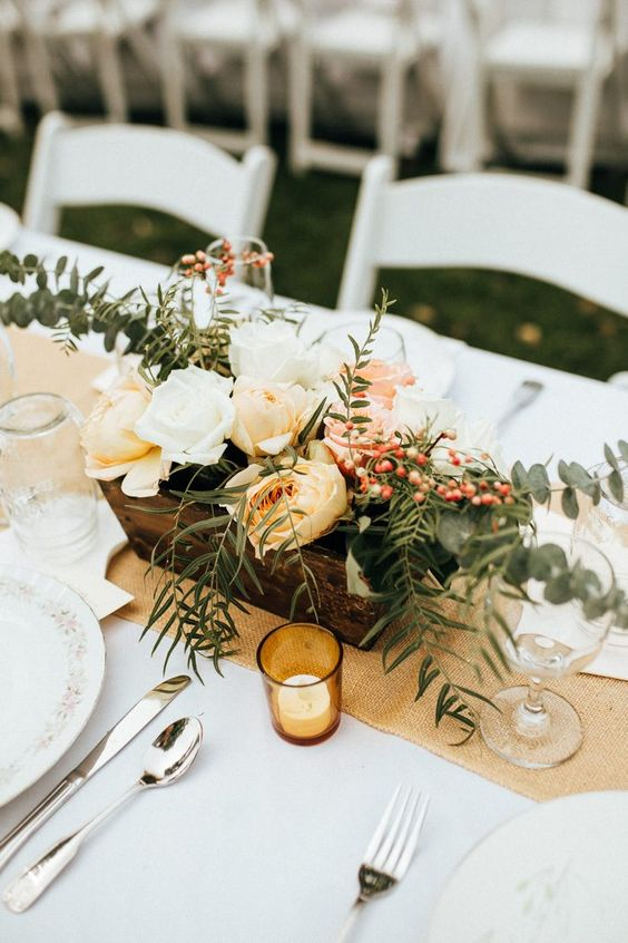 Retro bohemian table setting perfect for a barn or summer wedding. Via Junebug Weddings