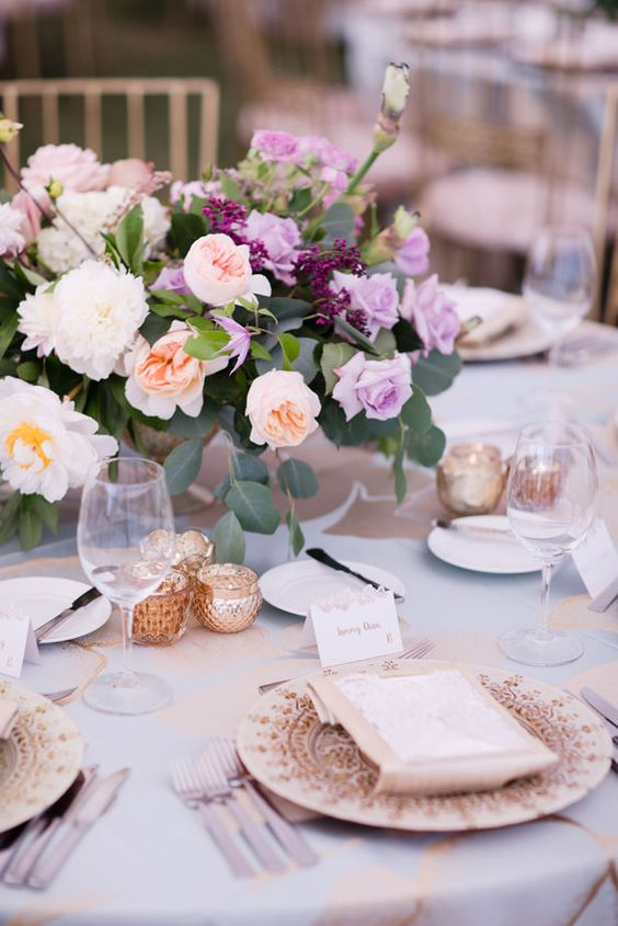Stunning table setting with lavender roses and a whimsical and sparkly touch. Via Belle the Magazine