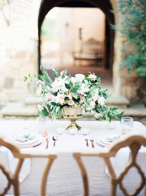 Sultry and romantic tablescape in a Spanish setting. Via Style Me Pretty
