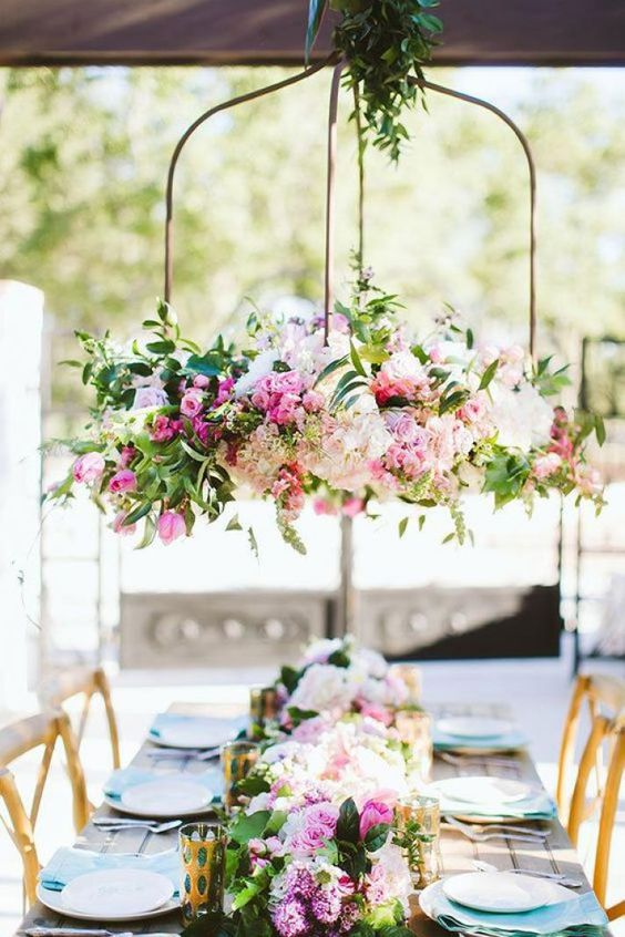 This huge eye-catching floral chandelier in soft pink tones is perfect for a summer wedding. Via The Flower Girl