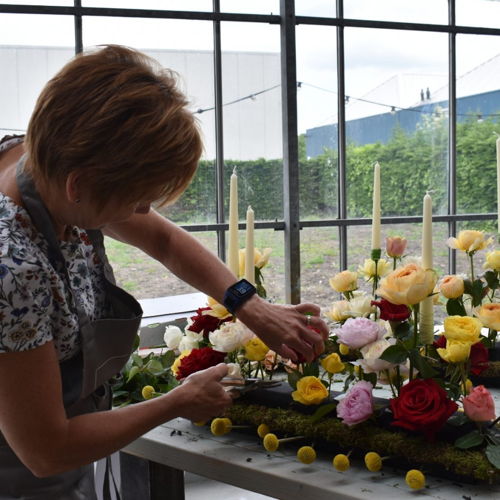 Florismart florist working at Max Hurtaud centerpiece design
